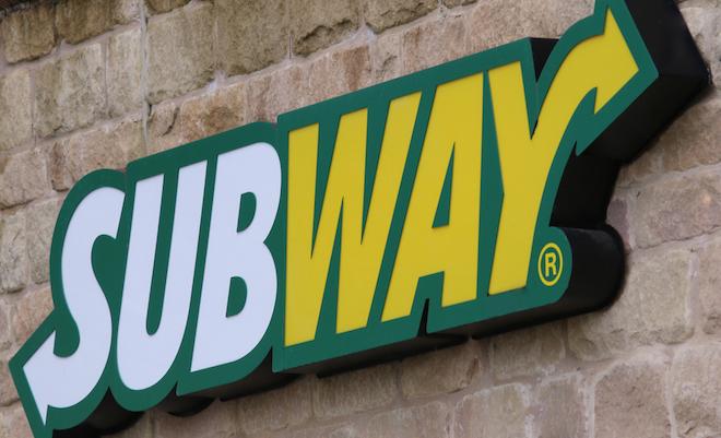 subway-logo-brick-wall